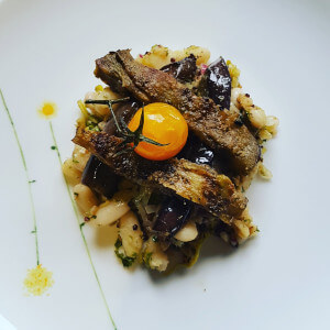 Pan fried aubergine strips with lemony white beans.