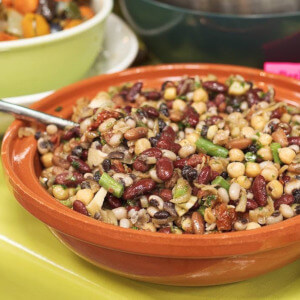 Mixed bean salad with caramelised onions, sun-dried tomatoes and dill.