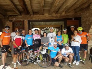 A group of cyclists pose for a photograph outside La Bonne Echappée.