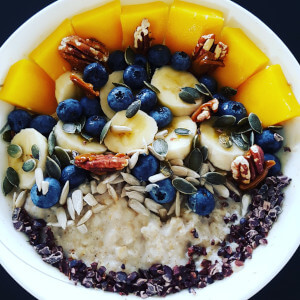 Oats with blueberry mango pecans sunflower seeds pumpkin seeds cocoa nibs.